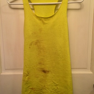 Hours later, after my spill on the trails, my new tank covered in blood, sweat, and dirt.